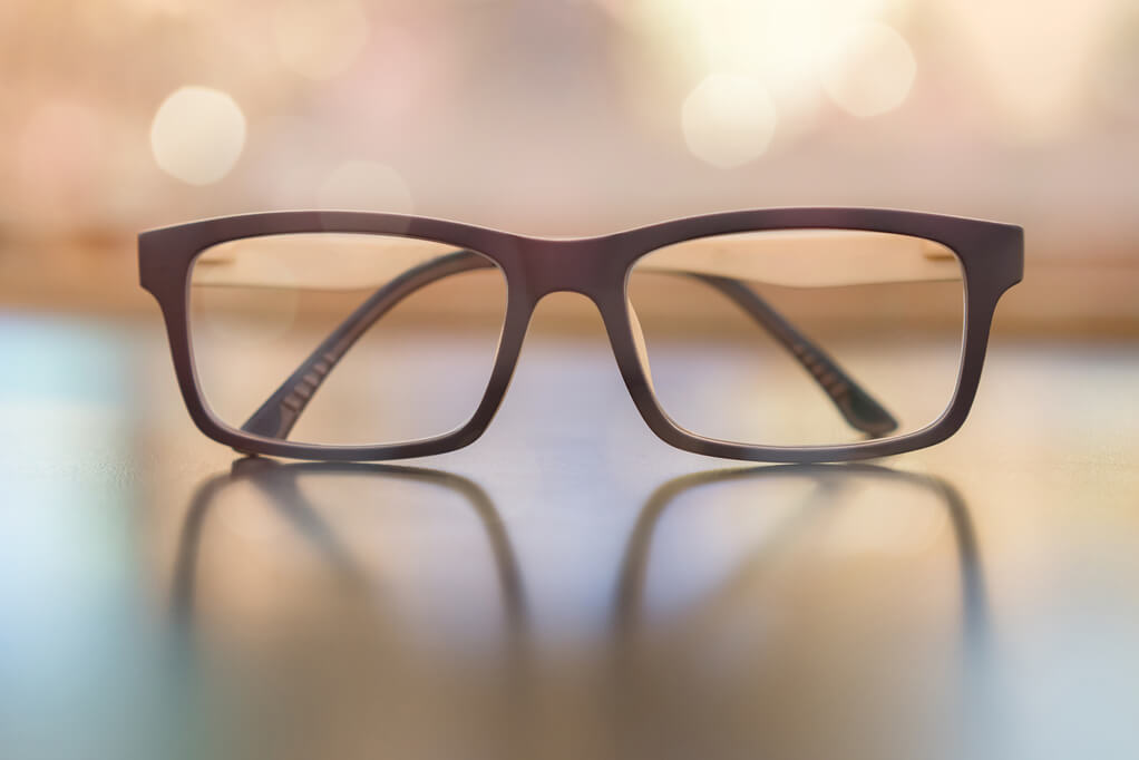 glasses sitting on table presbyopia