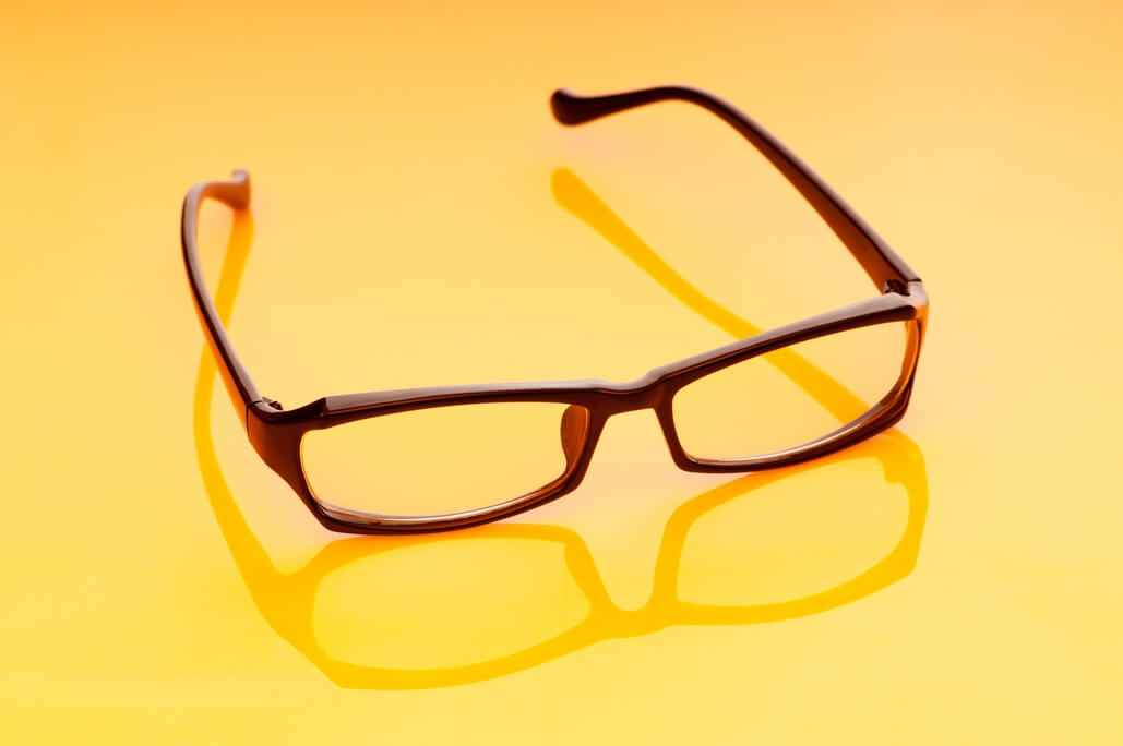 lens material and options frame on yellow background